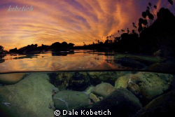 Half above / below image of a epic Laguna Beach sunset...... by Dale Kobetich 
